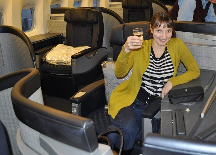 American Airlines Flagship First Class – Chicago to London – Emily Toasting The Start of Our Trans-Atlantic Journey!