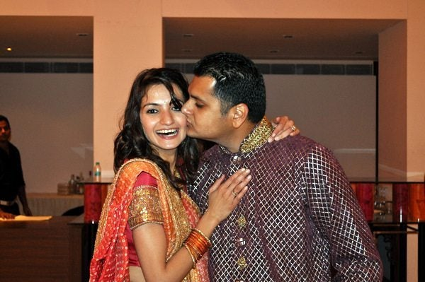 Gaurav kissing his bride
