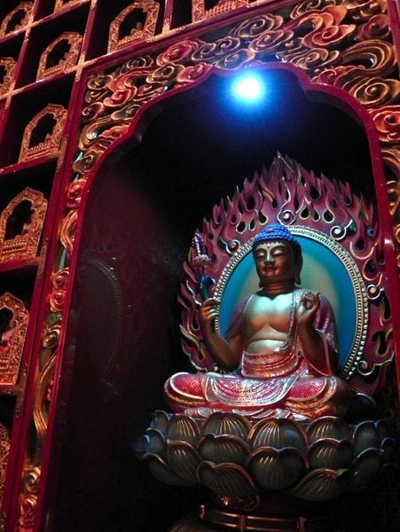 Buddha Inside The Temple Of The Tooth In Singapore