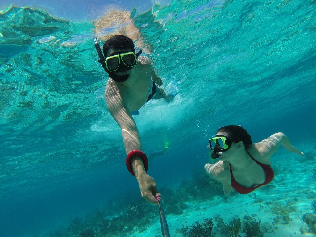 norkeling in the crystal clear waters of Grand Cayman Islands