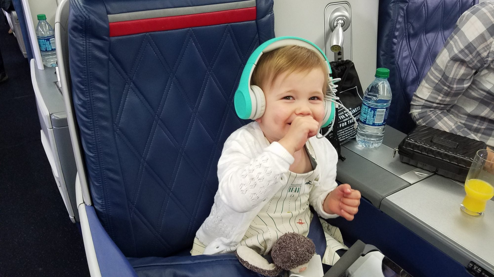 I Don't Care What You Think:  I Took My Toddler On a LONG Overnight Flight in Business Class and Loved It!
