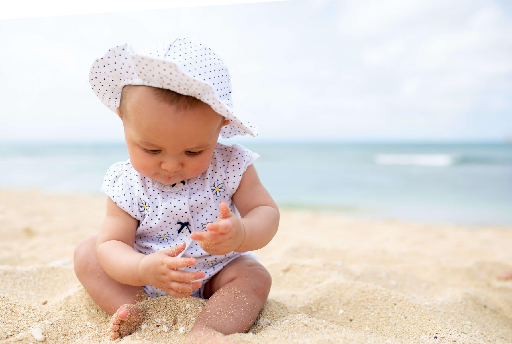 6 Months Old and Already Trying to Build Sand Castles