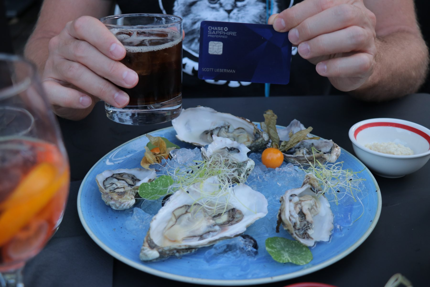 Earn 2X Chase Ultimate Rewards points at restaurants like I'm doing here eating lovely oysters while sipping an adult beverage