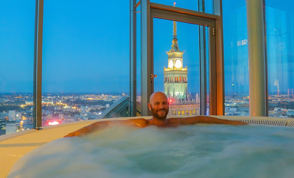 I'm in a Huge Hot Tub With an Amazing View of the Warsaw Palace of Culture at Night