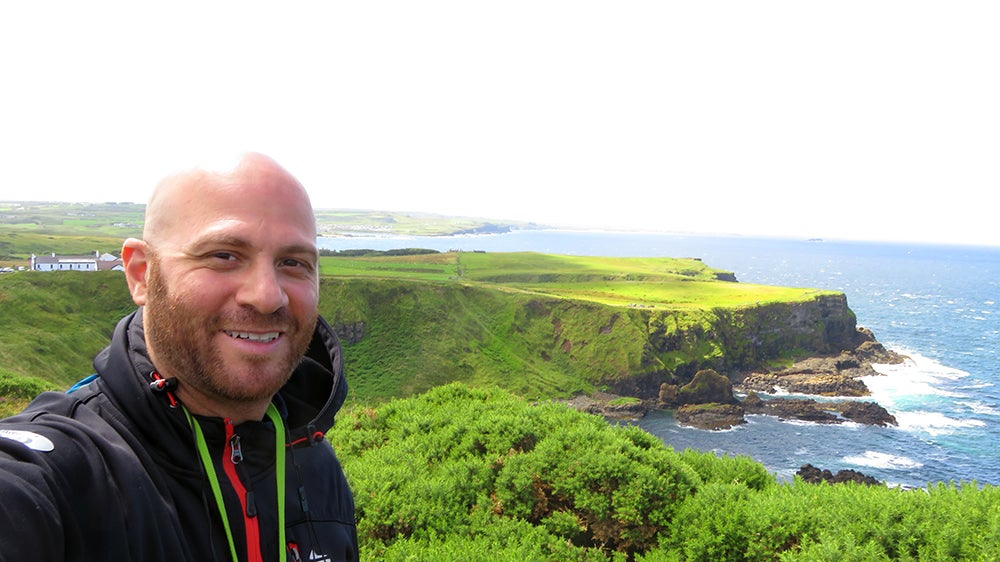 Using my Chase Sapphire Preferred points to see amazing green cliffs greeting the blue ocean in Northern Ireland