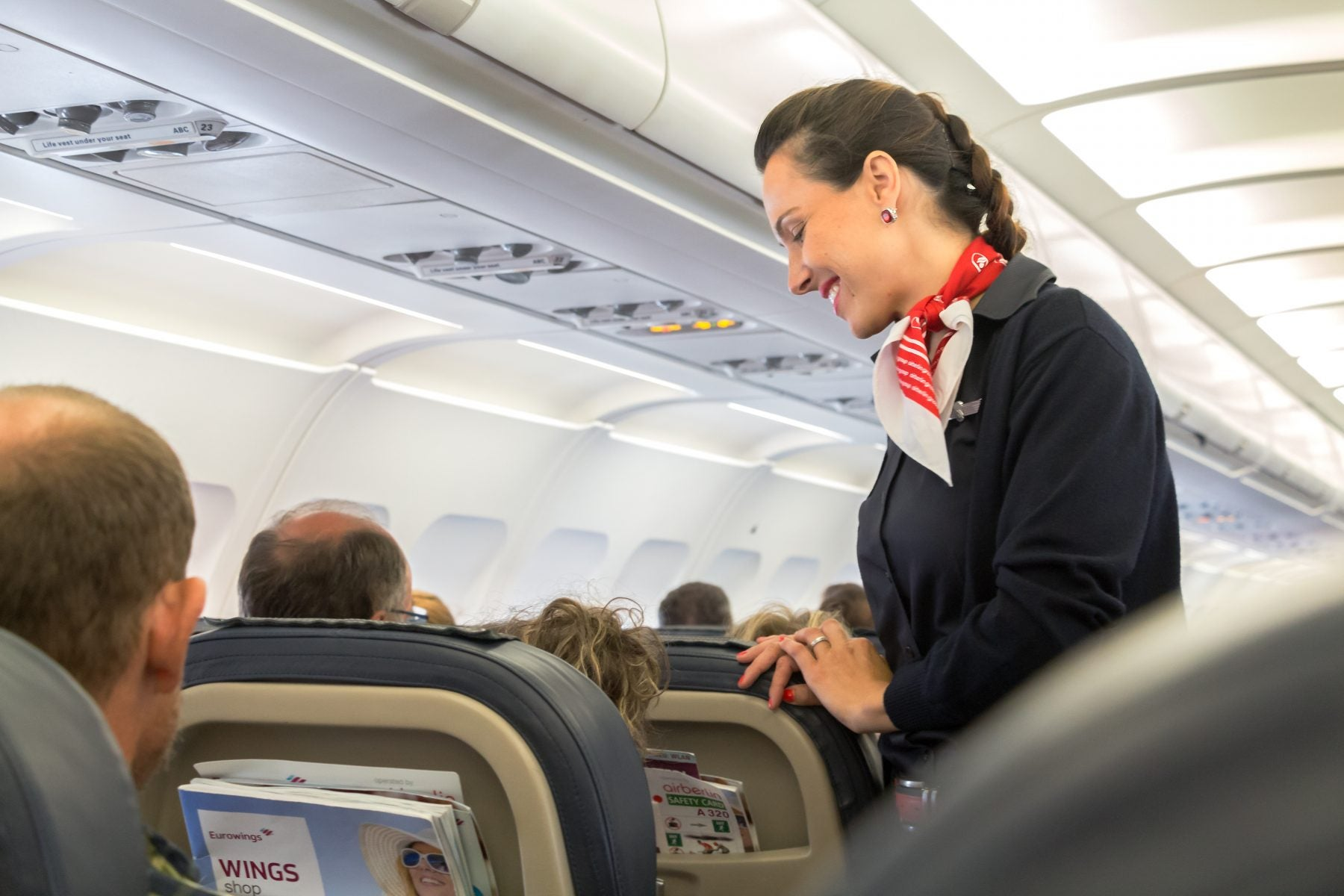 Friendly flight attendant re-assuring nervous guest