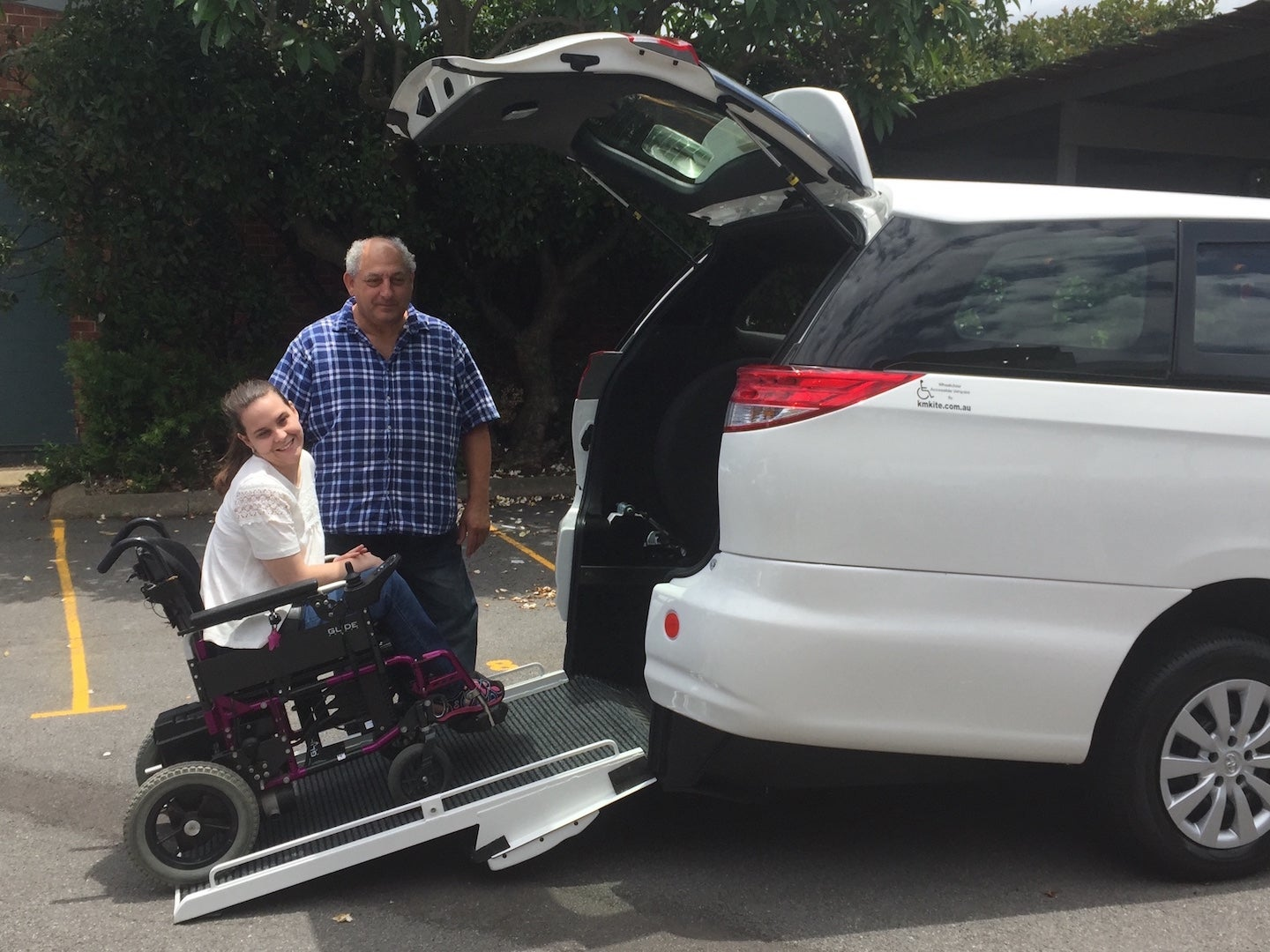 Picture of a wheelchair accessible van with a wheelchair ramp
